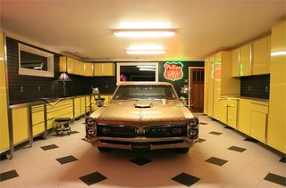 10 Prefab Garage Solutions For Auto Enthusiasts - Photo 8 of 10 - From beautiful carriage doors to stainless steel cabinets and antique memorabilia neon signs, Portland-based company Vault designs gorgeous spaces.