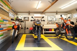 10 Prefab Garage Solutions For Auto Enthusiasts - Photo 6 of 10 - Add a dash of flair and color with rubber floor coating. Some of the advantages include a low cost and resistance, to mechanical and chemical damage. Rubber floors are also non-slip, resistant to extreme temperatures, and are easily repaired.
