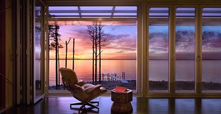 5 NanaWall Bifold Door Projects That Redefine Architectural Possibilities - Photo 1 of 5 - The project goals included providing savannah-like views of the Chesapeake Bay and opening the interior fully for natural ventilation. The plan also called for thermal insulation when the operable glass walls are closed.
