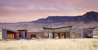 "5 NanaWall Bifold Door Projects That Redefine Architectural Possibilities - Photo 2 of 5 - For this Wyoming vacation home, the goal was to create a sustainable design that incorporated as many ""green"" materials as possible.  The NanaWall systems used are all-aluminum and have minimal sightlines which suited the aesthetics of the project."
