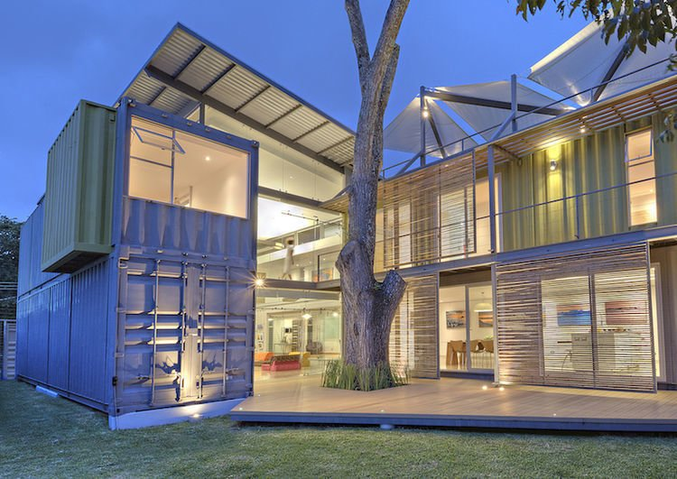 "The 8 used containers were sourced at the country's busy Caribbean port of Puntarenas, then stacked together to form a 2-story home and office. ""Designing with containers amplifies what I really like,"" says Trejos. ""In terms of versatility, good taste and modern architecture, this is how I love to design."""