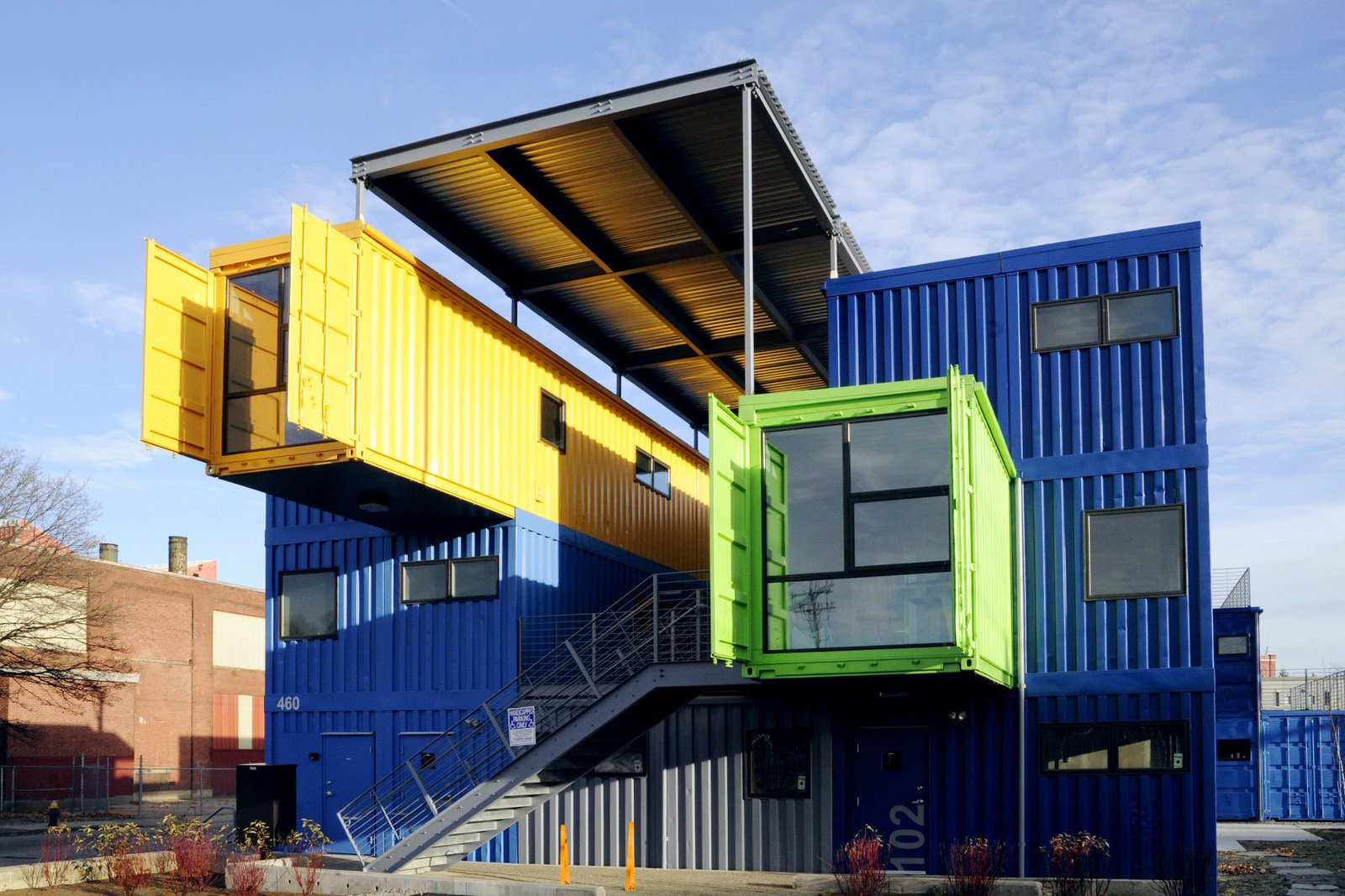 OK, technically it's not an island, nor is this a home, but we couldn't resist including this Rhode Island-based office/studio spaces constructed from 32 recycled shipping containers on an abandoned strip of Providence history - the former Harris Lumber site. This three-story, 12,000-square-foot complex, which sits  in a post-industrial section of Providence, is the largest office building in the United States made exclusively of cargo containers by Stack Design Build.  Photo 7 of 12 in 10 Beautiful Island-Style Shipping Container Homes