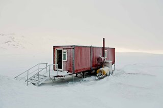 10 Beautiful Island-Style Shipping Container Homes - Photo 7 of 11 - When it comes to demonstrating the hardiness of shipping containers as homes in harsh environments, it doesn't get any more incredible than this example captured by photographer Bryce Johnson in the bleak wilderness of Iceland.