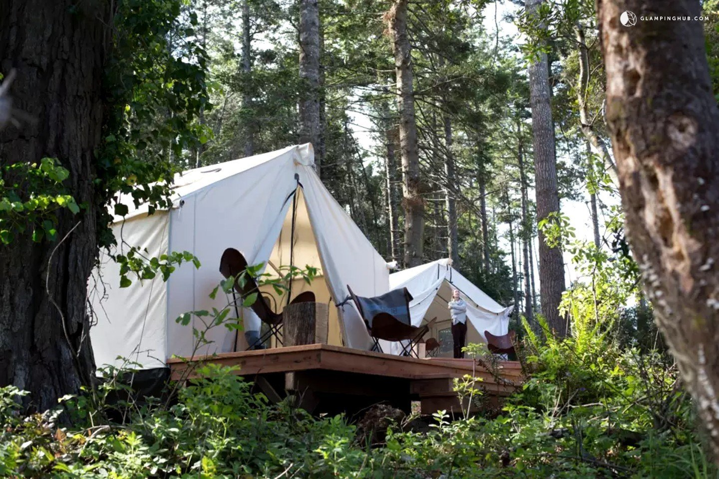 These roomy safari tents are 12-feet by 14-feet and housed on wooden platforms. They come fully outfitted with a queen-size bed, down comforter, and cotton linens so when there is a chill in the air, glampers know they will be warm and cozy at night. The tent has its own private deck complete with sling back chairs and a fire ring.  Photo 2 of 14 in 12 Terrifically Glamorous Camping Options