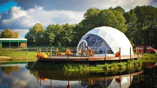 12 Terrifically Glamorous Camping Options - Photo 8 of 13 - Keeping it DIY: a greenhouse, a winter garden, a pop-up shop, a seasonal cafe, a sports facility, or an outdoor classroom? Whatever your needs may be, F.Domes delivers. Their self-assembly kits provide a fabulous environment for every use. Thanks to their quick and easy assembly, F.Domes are a popular choice among those looking for basic, yet rigid and beautiful outdoor structure.