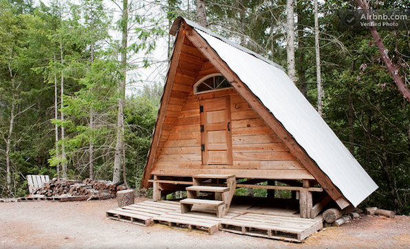 A small, rustic, hand-built cabin deep in the Northern California woods. Part of a remote, off-grid Tagged: Exterior, Wood Siding Material, Cabin Building Type, and A-Frame RoofLine.  Photo 4 of 12 in Alfie the A-Frame and 10 Other A-Grade Accommodations
