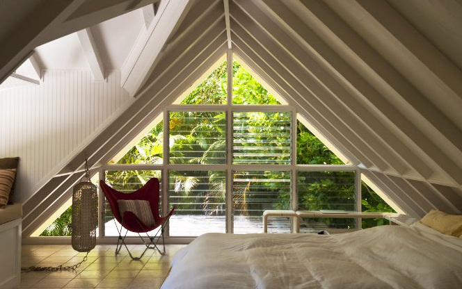 Travelers looking for cabin rentals in Hawaii, this is a real gem. A fresh, bright little cottage with great vintage charm and subtle yet fun design updates. This is fun mid-century style and simple living in paradise. Tagged: Bedroom, Bench, Bed, and Chair.  Photo 5 of 12 in Alfie the A-Frame and 10 Other A-Grade Accommodations