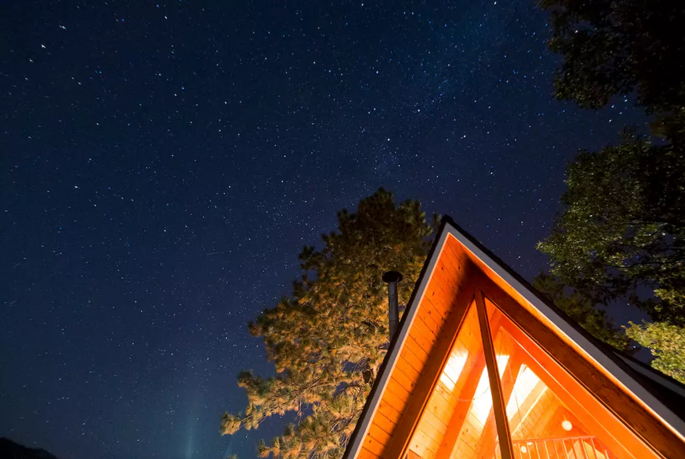 Perfectly located between Big Bear Lake and Lake Arrowhead, take in the gorgeous views from the big back deck. This charming and private A-Frame cabin is the ideal escape.  Photo 9 of 12 in Alfie the A-Frame and 10 Other A-Grade Accommodations