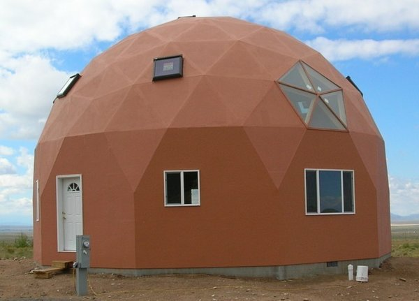 The standard EconoOdome may be fitted with arched trim boards above the windows and doors. This accent trim acts as a canal to control rain water flowing over the EconOdome surface.