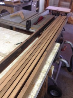 Once clean, planks were re-sawn on a table saw to get about 2 inch wide strips, then re-sawn again so that they were about a quarter inch thick.