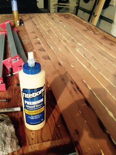 Titebond II to laminate the thin strips together for the top (deck) and bottom layers of the board.