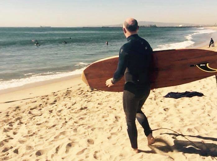 The surf was very small, perhaps the ideal conditions to take a test ride.  Photo 24 of 26 in Crafting a Hollow Wood Surfboard from Old-Growth Redwood
