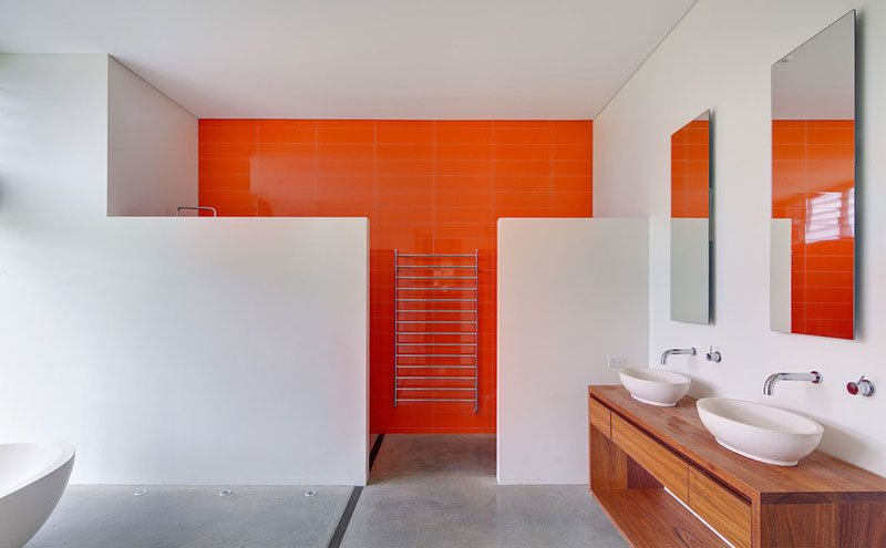 A bold color simply on one wall makes the difference in brightening this otherwise blank space.