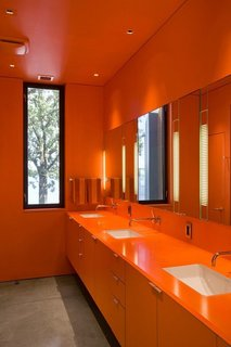 These 10 Designers Are Experts at Creating Colorful Bathrooms That Pop - Photo 3 of 11 - Orange enlivens this bathroom to the highest degree. Min Day has garnered numerous awards including the 2007 AIA California Emerging Talent award, New Practices San Francisco 2009, California Home & Design's 2009 Ten to Watch, Residential Architect's 2010 Rising Star, Architectural Record Magazine's 2009 Design Vanguard, and the Architectural League of New York's 2016 Emerging Voices.