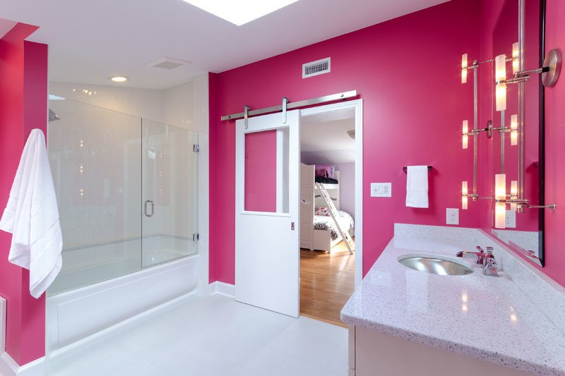 Pink heats up this renovation by Virginia-based Design Line. These 10 Designers Are Experts at Creating Colorful Bathrooms That Pop - Photo 7 of 11