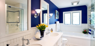 These 10 Designers Are Experts at Creating Colorful Bathrooms That Pop - Photo 9 of 11 - Minor changes to the layout of a modestly sized master bath transformed it into the space of these homeowners' dreams. Designer Gail Drury downsized the vanity and moved the toilet a few feet to allow for an addition of a whirlpool tub and new shower enclosure. A former linen closet accommodates the new glass shower enclosure. Other space-saving tricks include the addition of a shallow-depth linen cabinet, decorative open shelving, and an open vanity to make the room appear more spacious.