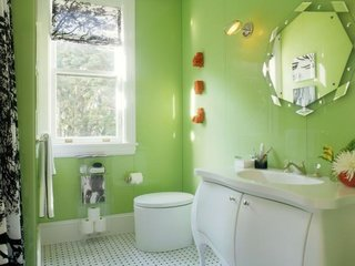 These 10 Designers Are Experts at Creating Colorful Bathrooms That Pop - Photo 10 of 11 - Apple green walls and an engaging floor pattern sparkle in this design by Steven Miller.