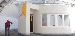 World's First 3D-Printed House Springs up in Russia in 24hrs - Photo 4 of 8 - German company BITEX provided unique finishing materials for the project: a mineral decorative plaster known as Reibeputz, and a high adhesion and vapor permeability and façade paint, Egalisationsfarbe, which is durable and resistant to adverse weather conditions. The paint is easy to apply and easily fills in roughness. After drying, it offers a solid matte surface without cracks, is eco-friendly, and resistant to weather conditions.