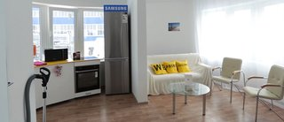 World's First 3D-Printed House Springs up in Russia in 24hrs - Photo 6 of 8 - Samsung provided high-tech appliances, including a TV set with the same radius of curvature as the curved walling of the house.