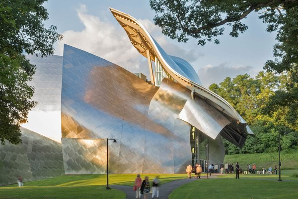 """For the Richard B. Fisher Center, Gehry worked in collaboration with acoustician Yasuhisa Toyota and a team of theater consultants. """"The front façade of the building can be interpreted as a theatrical mask that covers the raw face of the performance space. Its abstract forms prepare the visitor to be receptive to experiencing the performances that occur within,"""" Gehry said of his design."""