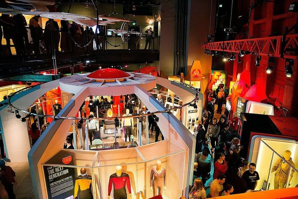 """in 2017 the """"Star Trek: Exploring New Worlds"""" was a featured exhibition at the Museum of Pop Culture. The Paul G. Allen museum has organized more than 57 exhibitions, 20 of which have traveled nationally and internationally. The museum, known for its futuristic Gehry design, also hosts more than 100 arts and cultural events each yea. The """"MoPOP"""" is housed in a 140,000-square-foot building set amid the backdrop of the Seattle Center. It was built with more than 21,000 aluminum and stainless steel shingles and 280 steel ribs."""