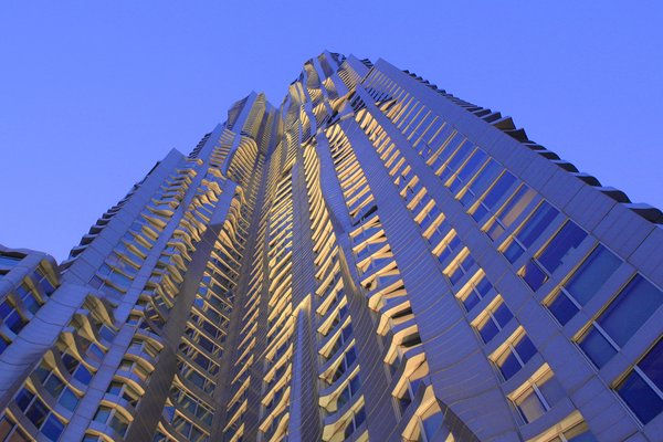 Gehry's building at 8 Spruce Street, New York, which features a rippling, undulating stainless steel facade, has become an iconic landmark that has captured both local and global attention and won critical acclaim.