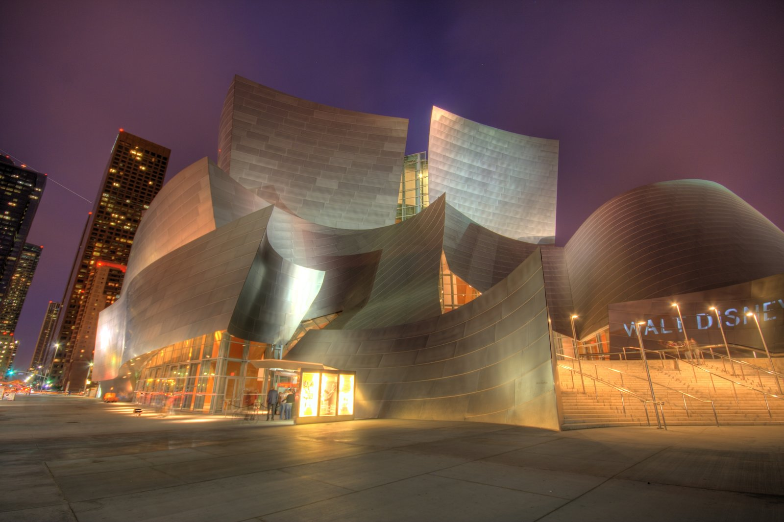 Walt Disney Concert Hall has received wide acclaim for its excellent acoustics and distinctive architecture. In the decade since its opening, the hall's sweeping, metallic surfaces have become associated with Frank Gehry's signature style. Tagged: Exterior.  Photo 3 of 14 in 13 Iconic Buildings Designed by Frank Gehry