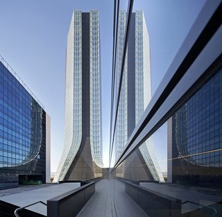 "Hadid's ""union of complexity and subtlety, daring and femininity in her works,"" appealed to CMA CGM Group. They commissioned her to design a new head office—a 147-meter-high tower and a 135-meter-long annex—to ""represent CMA CGM Group's daring and initiative."" The CMA CGM Tower is at once a symbol and a link between the port and the city of Marseille, anchoring the Group to its environment and its time."