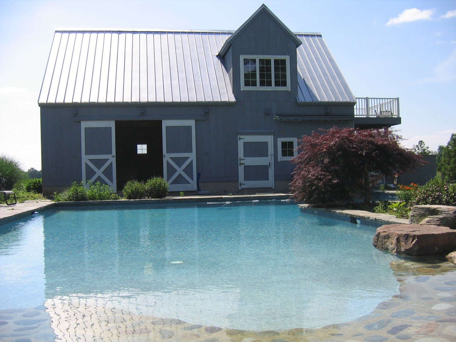 Through a collaboration with Ross Chapin Architects, the award-winning creator of GoodFit house plans, Shelter-Kit brings a range of kits for ready installation, such as this clever pool-side addition.  Photo 6 of 11 in 10 Prefab Barn Companies That Bring DIY to Home Building