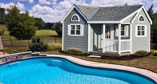10 Sunny Poolside Prefabs - Photo 10 of 10 - A Horizon Structures pool house shed is the ultimate in poolside comfort and utility. It can be used as storage for the kids' pool toys, a guest changing area, or as a place to store your pool chemicals, pump, and filtering system.
