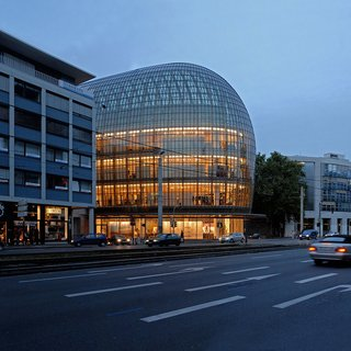 12 Renzo Piano Buildings We Love - Photo 3 of 12 - As a landmark in the city of Cologne, the curved front facade of this distinctive department store cantilevers subtly out into the area's pedestrian zone, strengthening the presence of the store along a major pedestrian and shopping axis.