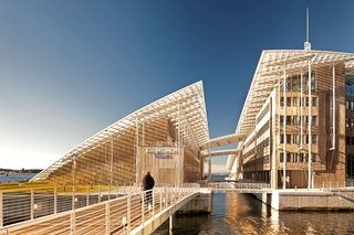 12 Renzo Piano Buildings We Love - Photo 4 of 12 - Designed to house the Astrup Fearnley Museum's permanent collection, this space also includes a separate space for its temporary exhibitions and an office building that has its own exhibition area for a private art collection. This strong, timber-clad shelter dwells under a single swooping glass roof in a newly landscaped public sculpture garden.