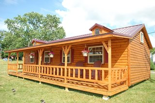 10 Prefab Log Home Companies - Photo 2 of 10 - Amish cabin homes come in five standard models that are available prefbuilt or as unassembled kits.   Prebuilt homes can be basic, which gives the customer an open-floor plan and an unfinished interior—and they're great for those working within a limited budget. The deluxe prebuilt versions are fully finished on the inside featuring bedrooms, bathrooms, a kitchen, insulation, electric setups, and more.
