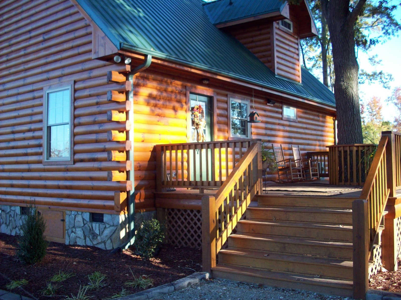 """Complete with over 1600 heated square feet, this log home gives you the """"country living"""" feel with a very large living space and wide open floor plan."""