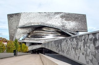 The Philharmonie de Paris, located in the Parc de La Villette, arrived amid much controversy, given that it was two-years late and three-times over budget. It consists of bird-shaped tiles that are interlocked and spread across the building's facade.