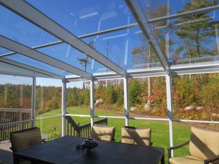 "An important technical consideration, Halifax Sunrooms re-assures that the glass in their models contains protection from UV rays and comes in choices of a ""smoke"" or ""charcoal"" tint. The construction material is further also flame-proof and contains a protective fungicide, while the roof is made with tempered safety glass and designed for the installation of ceiling blinds."