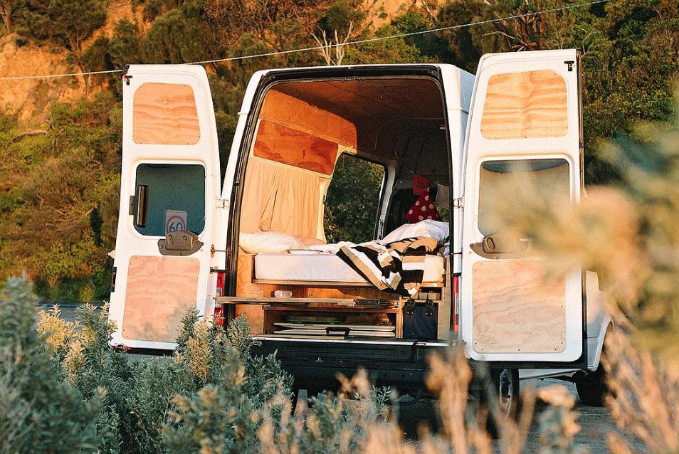 This Australian couple are making a living off the land, so to speak, from their double volume ceilinged panel van; traversing the countryside, making things with plants and selling them when possible.  Photo 4 of 11 in 9 Adventure Seekers Who Celebrate Small Space Living Through the Van Life