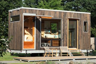 12 Prefab Guesthouses You'll Want to Put in Your Own Backyard - Photo 6 of 12 - At this guest suite in Greenwich, Connecticut, Cubist Engineering used 3-inch thick cross-laminated timber panels to build the 160-square-foot space. Elements like sliding doors and a bed that stays lofted to the ceiling during the day help to make the most of the tight quarters. The retreat was also designed to be on the move: it sits on a custom galvanized steel foundation with removable wheels and hitch, so it can be easily transported and then dropped directly on the ground, removing the need for a crane or big crew. The modular aluminum and garapa deck can be expanded or reconfigured with just two people.