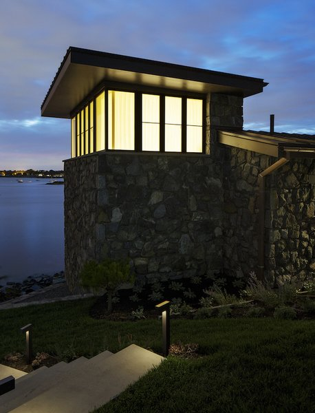 Modern home with outdoor, side yard, walkways, shrubs, and grass. The tower at dusk. Photo 6 of The Lighthouse