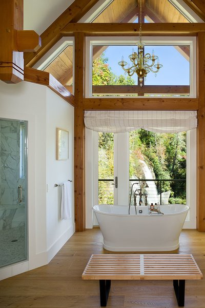Bathroom with a view, custom carved timber framed pendants.  Photo 8 of Contemporary Timber Frame Home Overlooking Twin Waterfalls modern home