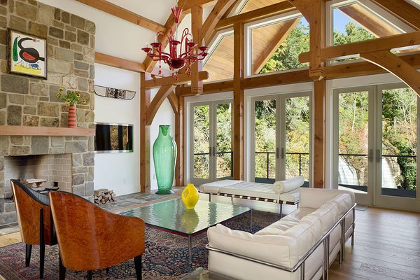 Open floor plan allows for plentiful light, unparalleled views. Hand-carved, handcrafted timbers. Photo 7 of Contemporary Timber Frame Home Overlooking Twin Waterfalls modern home