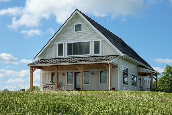 The barn style home, nestled atop a hayfield. Photo 2 of Timber Frame Barn Home in a Hayfield modern home