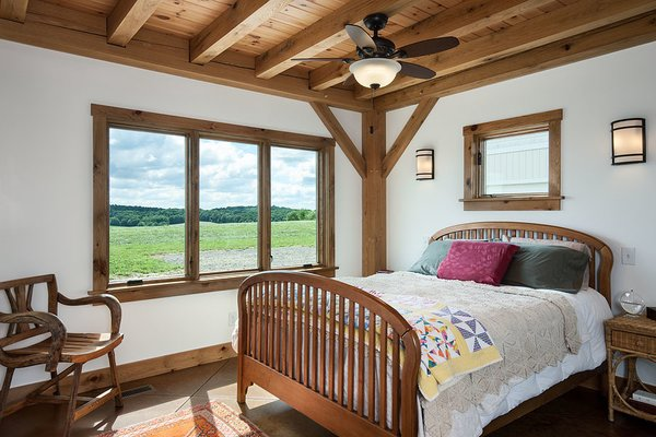 The master bedroom. Photo 4 of Timber Frame Barn Home in a Hayfield modern home