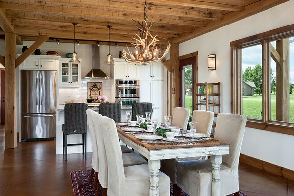 The kitchen and dining room flow directly from the open living room... the views continue as well. Photo 6 of Timber Frame Barn Home in a Hayfield modern home
