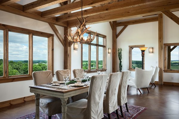 The handcrafted timber frame adds both drama and simplicity. Photo 7 of Timber Frame Barn Home in a Hayfield modern home