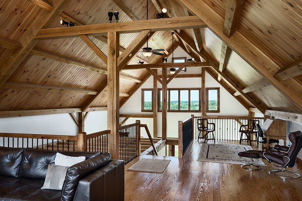 The loft is open and bright, and serves multiple purposes. Photo 9 of Timber Frame Barn Home in a Hayfield modern home