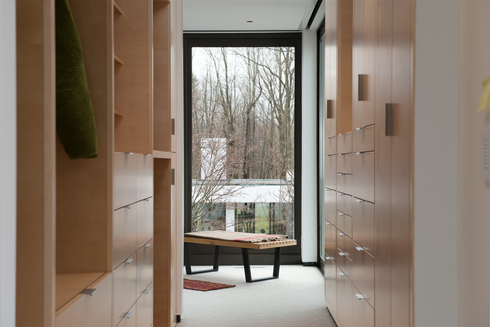 Open walk-in closet Tagged: Bedroom. House in the Woods by Kim Smith