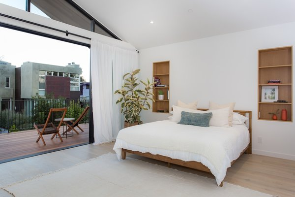 Modern home with bedroom, bed, storage, chair, shelves, and light hardwood floor. Photo 6 of Love Street Residence