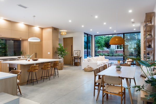 Modern home with kitchen, wood cabinet, pendant lighting, concrete floor, engineered quartz counter, and recessed lighting. Photo 2 of Love Street Residence