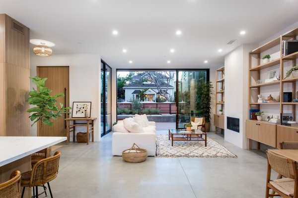 Modern home with living room, chair, recessed lighting, sofa, coffee tables, concrete floor, and standard layout fireplace. Photo 3 of Love Street Residence
